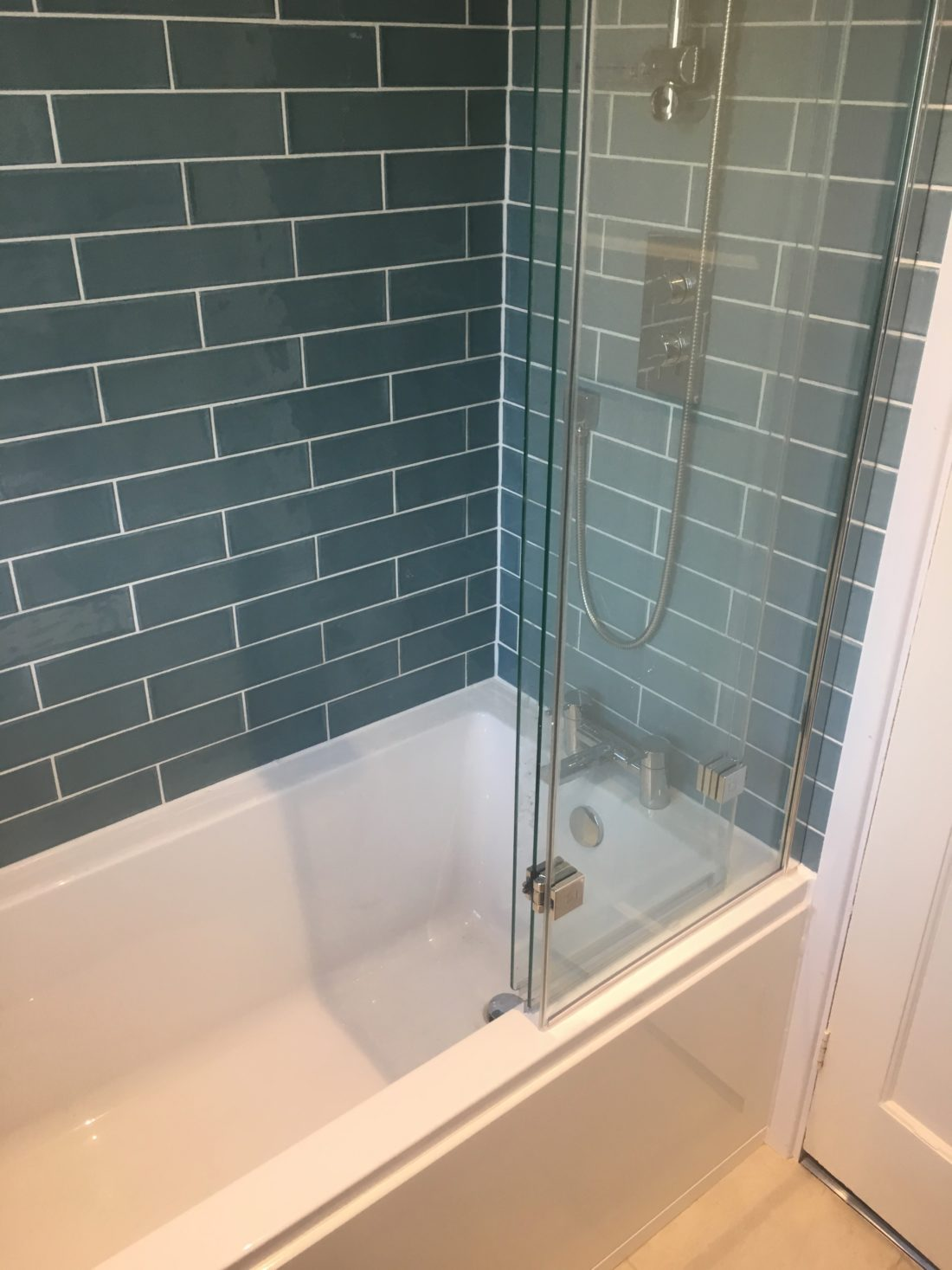 Green tiled top quality bathroom remodel by DSB Ltd Torbay